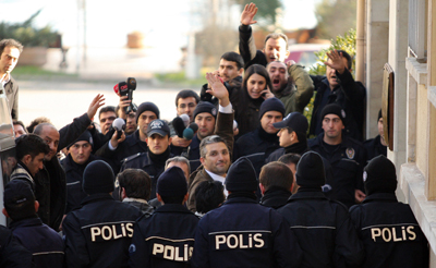Journalists Nedim Sener and Ahmet Sik react as they arrive to a courthouse in Istanbul