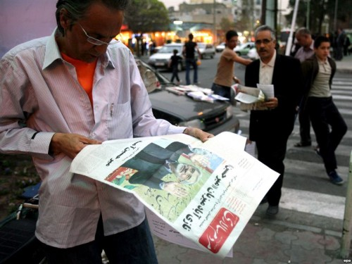 A man reads a newspaper with a story on opposition leader Mir Hossein Musavi on it in Tehran. (file photo)