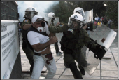 a-protester-and-policeman-clash-in-thessaloniki