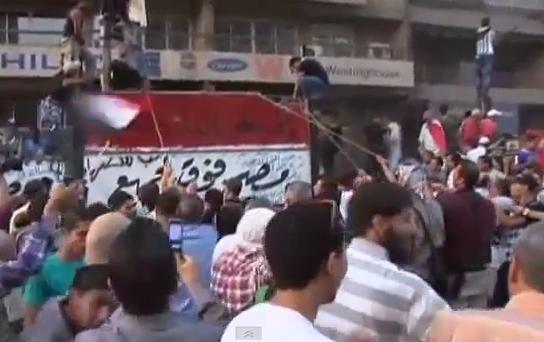 Protestors breach the Israeli Embassy's walls