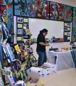 bryan-parras-sets-up-a-table-of-book-donations