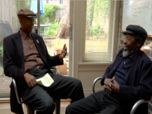 K. Mensah Wali (left) talks with Keorapetse Kgositsile