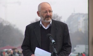 Peter Bradley speaks at the Brandenburg Gate in Berlin as part of an SCT-organized event in 2011. Photo: Google Free Expression.