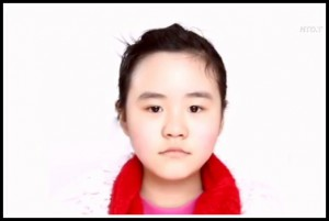 Zhang Anni, daughter of Chinese activist Zhang Lin, was detained by police at her elementary school. Photo: NT Don China via YouTube.