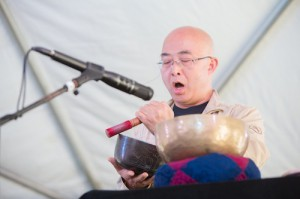Liao Yiwu plays the Tibetan bowls. Photo: Renee Rosensteel