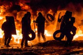protestors-throwing-tires-into-the-fire