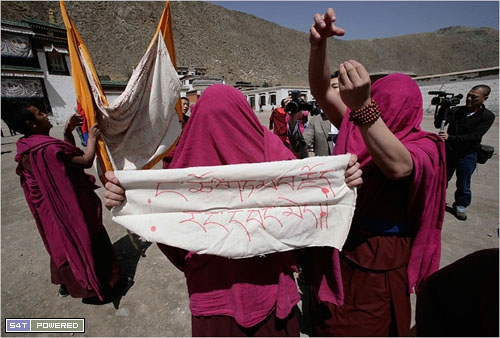 Monks with covered faces protesting Chinese involvement in Tibet
