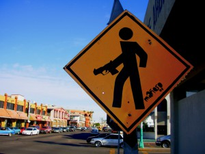 Street sign depicting the prevalence of gun violence in Mexican streets. Photo: mañsk