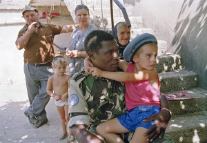 A UN soldier part of the UN Protection Force in Croatia and Bosnia and Herzegovina meets a family in a predominantly Serbian village near Knin. Photo: John Isaac/UN Photo