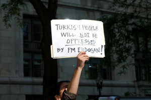 A protestor holding a sign expressing opposition against Turkish PM Erdogan Photo by Ceyhun Isik via Flickr