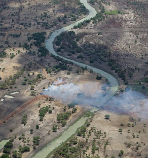 Aerial view of burned homes in Abyei, on the border of South Sudan in 2011. Years of ethnic violence have followed the Second Sudanese Civil War. Photo via Flickr user: United Nations Photo.