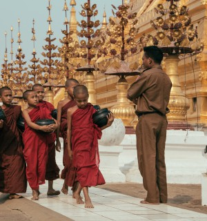 Young monks walk together outside of temple.