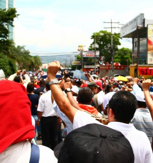Protesters in Honduras stand against . Photo via Wikimedia Commons.
