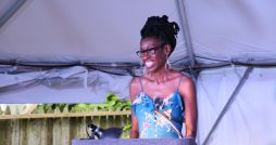 Cave Canem poet Lyrae Van Clief-Stefanon reads in the Alphabet City Tent. Image via City of Asylum. Rights reserved.